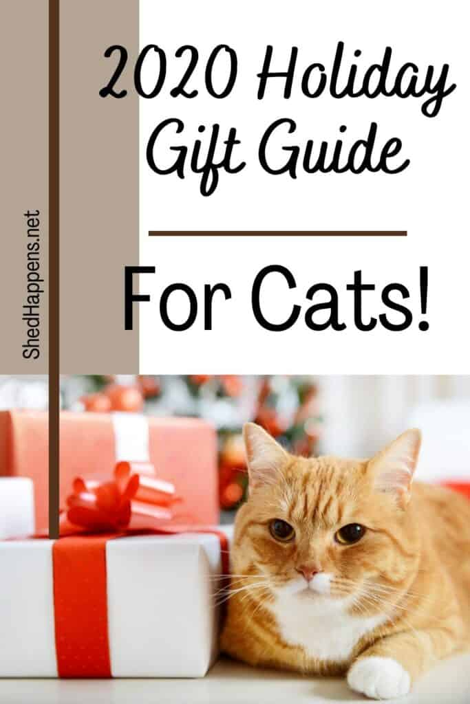 orange tabby cat with a white chest laying on a white surface next to a pile of red and white wrapped Christmas gifts with text announcing a gift guide of cat gifts